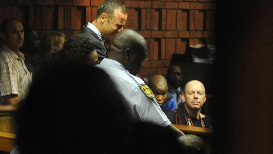 Feb. 15, 2013: South African athlete Oscar Pistorius reacts,  in court in Pretoria, South Africa at his bail hearing in the murder case of his girlfriend Reeva Steenkamp.