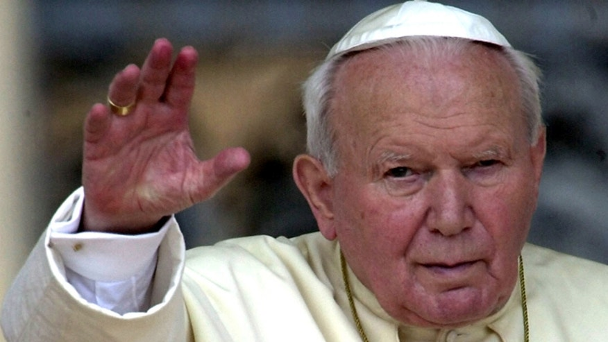 In this May 2, 2001 file photo, Pope John Paul II waves to faithfuls gathered for the weekly general audience at St. Peter's Square in the Vatican.