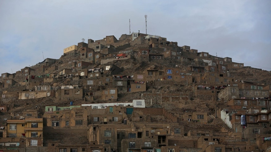 Mud made houses are build on a hill in a staircase pattern in Kabul, Afghanistan, Wednesday, Jan. 29, 2014. The war-torn country still faces the challenges of poverty, unemployment and a lack of infrastructure. (AP Photo/Massoud Hossaini)
