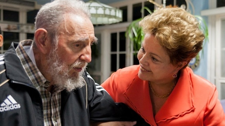 Jan. 27, 2014: In this photo released by Cubadebate, Brazil's President Dilma Rousseff visits with Cuba's former President Fidel Castro in Havana, Cuba.