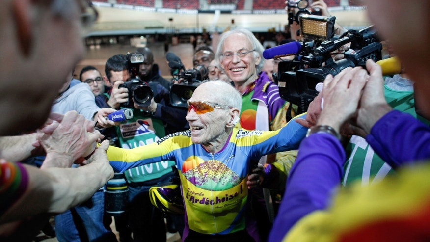 Jan. 31, 2014: French cyclist Robert Marchand, aged 102, celebrates with fans after beating his record for distance cycled in one hour, at the velodrome of Saint-Quentin en Yvelines, outside Paris.