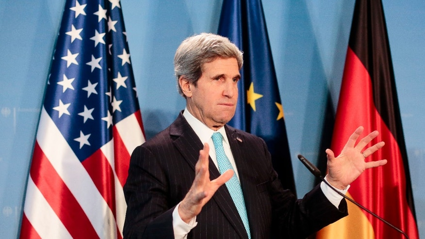 US Secretary of State John Kerry briefs the media after a meeting with German Foreign Minister Frank-Walter Steinmeier at the airport Tegel in Berlin, Germany, Friday, Jan. 31, 2014. Kerry is on a stopover in the German capital en route to the Munich Security Conference. (AP Photo/Markus Schreiber)