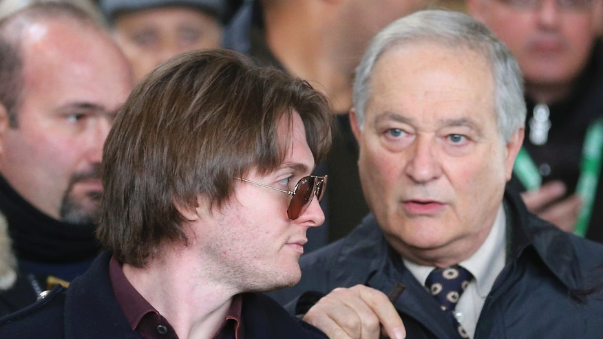 Raffaele Sollecito, left, and his father Francesco leave after attending the final hearing before the third court verdict for the murder of British student Meredith Kercher, in Florence, Italy, Thursday, Jan. 30, 2014. The first two trials produced flip-flop verdicts of guilty then innocent for Kercher former roommate, American student Amanda Knox, who is not attending the hearing,  and her former Italian boyfriend, Raffaele Sollecito, and the case has produced harshly clashing versions of events. A Florence appeals panel designated by Italy's supreme court to address issues it raised about the acquittal is set to deliberate Thursday, with a verdict expected later in the day. (AP Photo/Antonio Calanni)