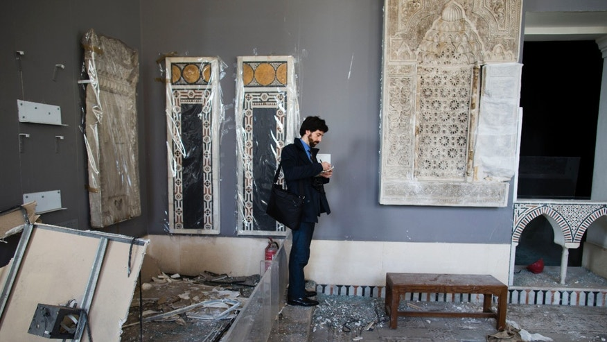 An UNESCO delegation member records the damage of the Museum of Islamic Art in Cairo, Egypt, Friday, Jan. 31, 2014. The U.N. agency visited the museum where centuries-old artifacts were destroyed by a bombing that also ripped through the nearby Cairo police headquarters a week ago. (AP Photo/Hassan Ammar)