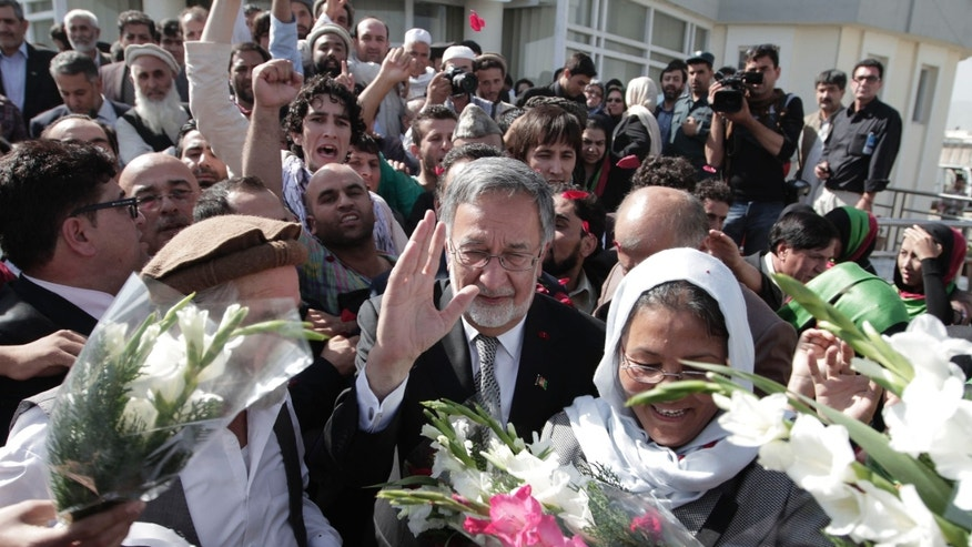 FILE - In this Sunday, Oct. 6, 2013 file photo, former Foreign Minister Zalmai Rassoul waves at his supporters after registering his candidacy in the 2014 presidential election in Kabul, Afghanistan. A former foreign minister, Rassoul has been national security adviser to the government and is seen as close to Karzai. He could end up being a consensus candidate among many political factions. A Pashtun like Karzai, he has a medical degree and is fluent in five languages, including French, English and Italian. (AP Photo/Rahmat Gul, File)