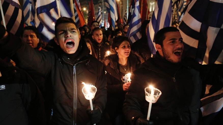 Supporters of Greece's extreme right party Golden Dawn sing the national anthem during a rally in Athens on Saturday, Feb.1, 2014. About 3,000 people took part in the rally to commemorate a 1996 incident which cost the lives of three navy officers and brought Greece and Turkey to the brink of war. A number of leftist groups held two separate counter-rallies a short distance away, but police forbade the groups from marching and meeting each other to prevent violent incidents. Six lawmakers of the party, including the Golden Dawn's leader Nikolaos Michaloliakos, are in jail on charges of being prominent members of a criminal organization. (AP Photo/Yannis Kolesidis)