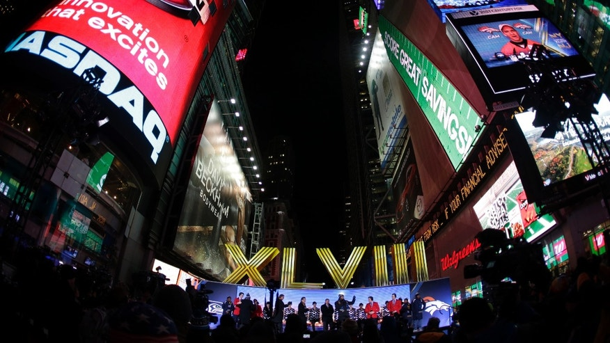 The Roman numerals for Super Bowl XLVIII are unveiled on Super Bowl Boulevard in Times Square Wednesday, Jan. 29, 2014, in New York. The Seattle Seahawks are scheduled to play the Denver Broncos in the NFL Super Bowl XLVIII football game on Sunday, Feb. 2, in East Rutherford, N.J.  (AP Photo/Charlie Riedel)