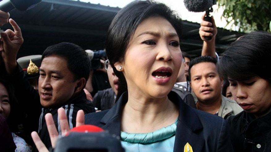 Feb. 2, 2014: Thai Prime Minister Yingluck Shinawatra leaves a polling station after casting her ballot for the general election in Bangkok, Thailand.
