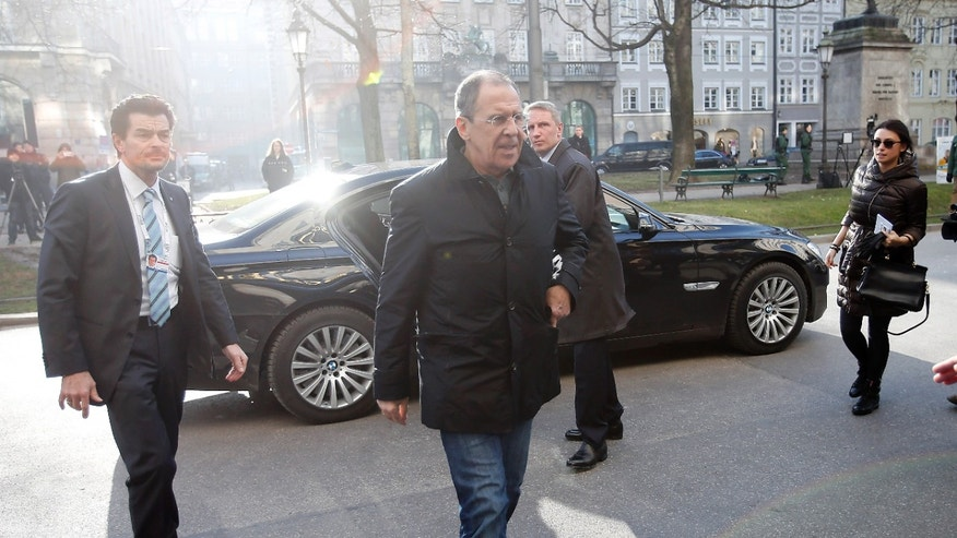 Russian Foreign Minister Sergey Lavrov arrives for the 50th Security Conference in Munich, Germany, Friday, Jan. 31, 2014. The conference on security policy takes place from Jan. 31, 2014 until Feb. 2, 2014.(AP Photo/Frank Augstein)