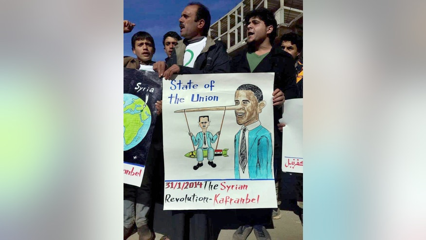 In this image provided by Edlib News Network (ENN), an anti-Bashar Assad activist group, which has been authenticated based on its contents and other AP reporting, anti-Syrian government protesters chant slogans as they hold a placard resembling U.S. President Barack Obama, right, and Syrian President Bashar Assad during a demonstration in Kafr Nabil town, Idlib province, northern Syria, Friday, Jan. 31, 2014. (AP Photo/Edlib News Network ENN)