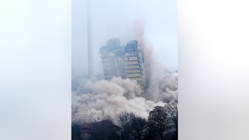 A former university tower is blown up followed by thousands of spectators in Frankfurt, Germany, Sunday, Feb. 2, 2014.  (AP Photo/Michael Probst)