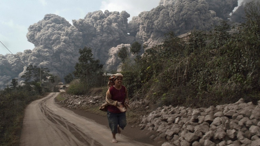 Feb. 1, 2014: A villager runs as Mount Sinabung erupt at Sigarang-Garang village in Karo district, Indonesia's North Sumatra province.