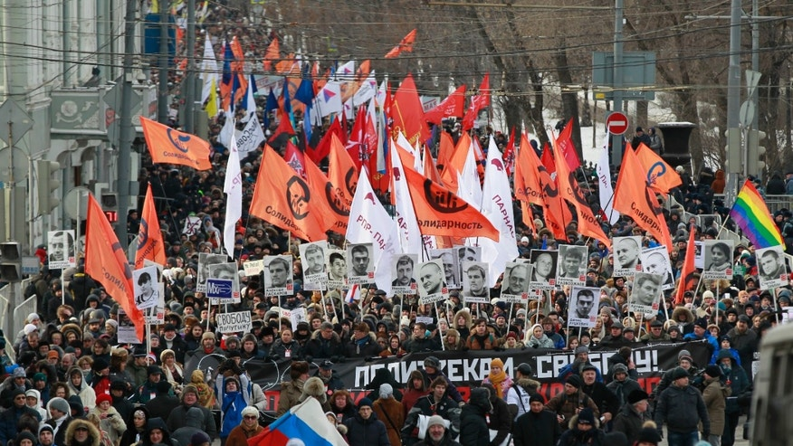 Feb. 2, 2014: Opposition demonstrators carry posters of imprisoned protesters during a protest rally in Moscow, Russia. Several thousand Russian opposition supporters gathered for a protest on Sunday, venting anger against the Kremlin and demanding the release of political prisoners.