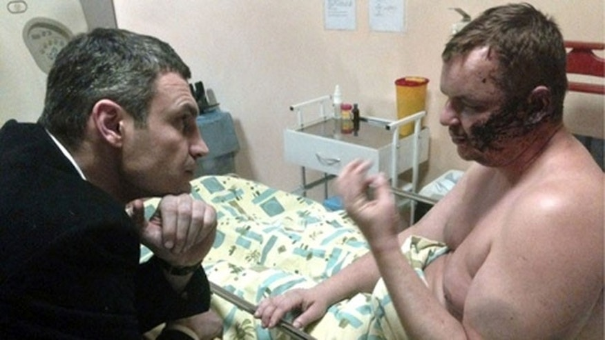 January 31, 2014: Ukrainian opposition leader Vitali Klitschko speaks to activist Dmytro Bulatov in hospital (AP)