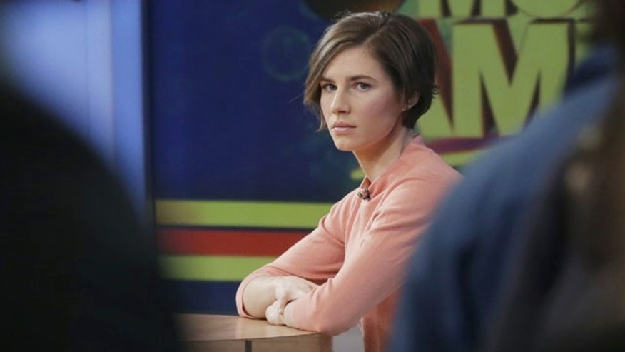 "January 31, 2014: Amanda Knox waits on a television set for an interview in New York. Knox said she will fight the reinstated guilty verdict against her and an ex-boyfriend in the 2007 slaying of a British roommate in Italy and vowed to ""never go willingly"" to face her fate in that country's judicial system . ""I'm going to fight this to the very end,"" she said in an interview with Robin Roberts on ABC's ""Good Morning America."" (AP Photo/Mark Lennihan)"