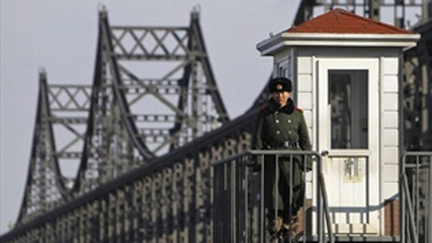 The Sino-Korean Friendship Bridge connects North Korea to the Chinese border town of Dandong, allowing workers, under the watchful eye of North Korean minders, to come work in China. (Reuters)
