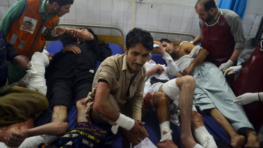 Injured victims of an explosion are treated at a local hospital in Peshawar, Pakistan, Sunday, Feb. 2, 2014.  Two blasts ripped through a crowded cinema hall in the northwestern city of Peshawar, killing several people and injuring dozens. Police said two hand grenades were hurled inside the cinema by unknown attackers, local media reported. (AP Photo/Mohammad Sajjad)