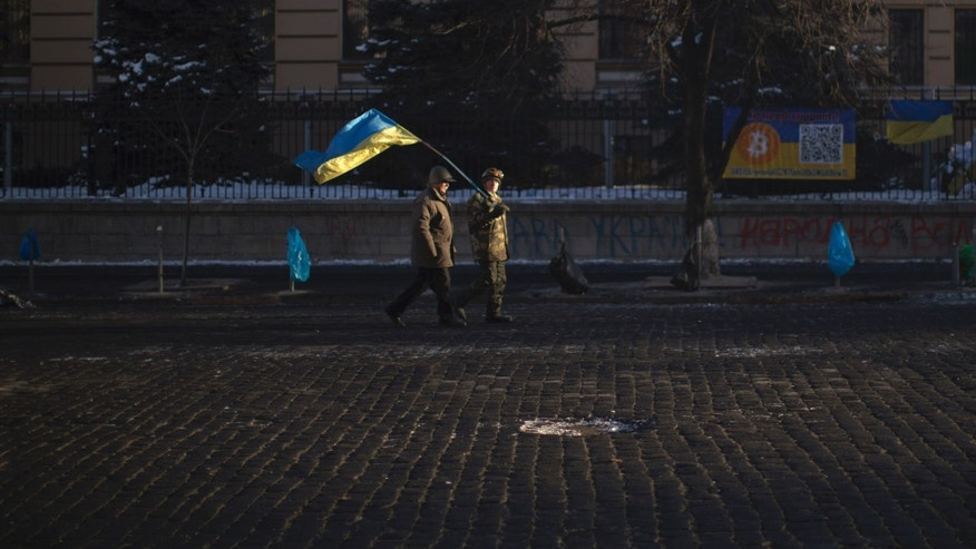 Feb. 3, 2014 - Opposition supporters walk along a street heading to Kiev's Independence Square, the epicenter of the country's current unrest. Ukraine's president will return Monday from a short sick leave that had sparked a guessing game he was taking himself out of action in preparation to step down or for a crackdown on widespread anti-government protests.