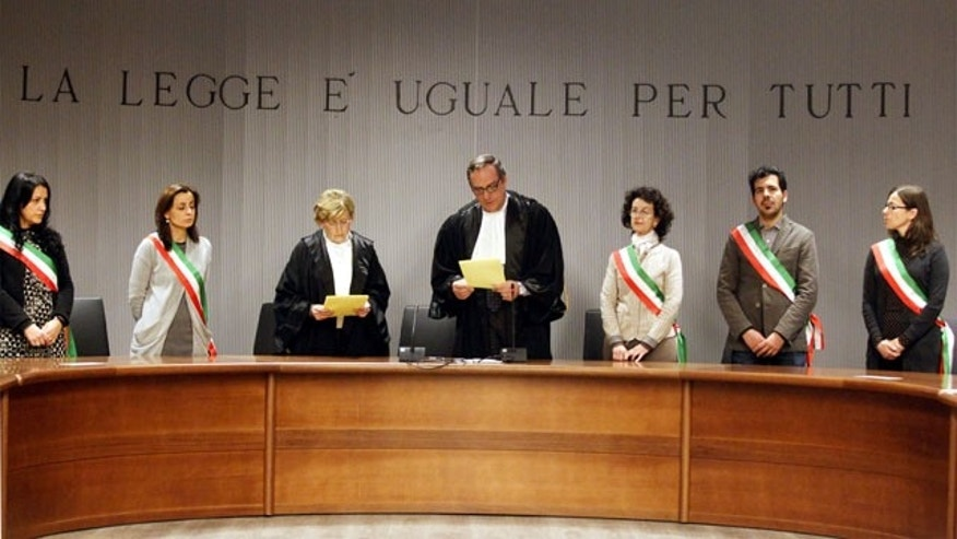 January 30, 2014: Appeals Court Judge Alessandro Nencini, center, reads out the verdict for the murder of British student Meredith Kercher, in Florence, Italy. An appeals court in Florence upheld the convictions of U.S. student Amanda Knox and her ex-boyfriend for the 2007 murder of her British roommate. (AP)