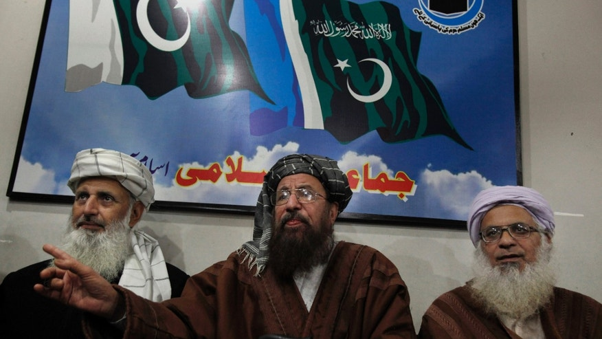 Pakistani religious clerics and members of Taliban's negotiating committee, from left to right, Professor Ibrahim Khan, Maulana Sami-ul-Haq, and Maulana Abdul Aziz, answer a question during their press conference in Islamabad, Pakistan, Tuesday, Feb. 4, 2014. A three-member committee appointed by Pakistani Taliban to hold peace talks with Pakistan has accused its Pakistani counterparts of scuttling the peace process by not turning up for the first round of talks in the capital. (AP Photo/Anjum Naveed)