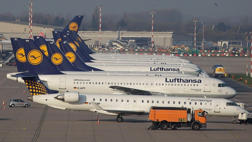 "FILE - In this April 22, 2013 file photo Lufthansa Airplanes are parked during a warning strike of employees of the German airliner Lufthansa in Duesseldorf, Germany.  A German union says pilots at the country's biggest airline, Lufthansa, will vote on whether to go on strike in a long-running pay dispute. The Vereinigung Cockpit union said Tuesday, Feb. 4, 2014, that it will announce the results of the ballot of about 5,400 pilots at Lufthansa, Lufthansa Cargo and the company's budget airline Germanwings on March 21. It said the several-week interval gives the company time to ""correct its course and avoid strikes."" (AP Photo/Frank Augstein, File)"