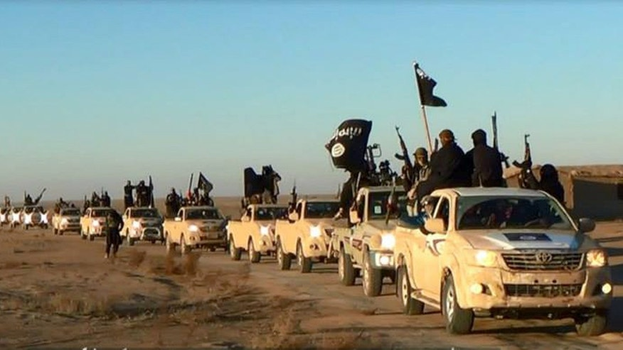 "FILE - This file image posted on a militant website on Tuesday, Jan. 7, 2014, which is consistent with AP reporting, shows a convoy of vehicles and fighters from the al-Qaida linked Islamic State of Iraq and the Levant (ISIL) in Iraq's Anbar Province. The  ISIL led by Abu Bakr al-Baghdadi is the main driver of destabilizing violence in Iraq and until recently was the main al-Qaida affiliate there. Al-Qaida's general command formally disavowed the group this week, saying it ""is not responsible for its actions."" (AP Photo via militant website, File)"