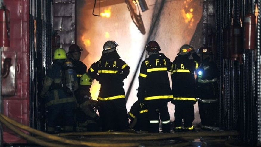 Feb. 5, 2014: Firefighters work to extinguish a fire at the Iron Mountain warehouse in Buenos Aires, Argentina.