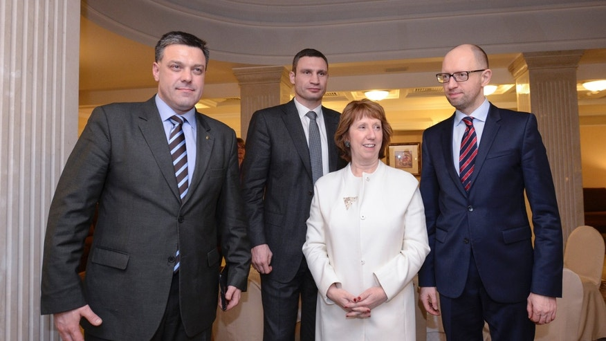 EU Foreign Policy chief Catherine Ashton, second right, poses prior to her meeting with Ukrainian opposition leaders, Oleh Tyahnybok, left, Arseniy Yatsenyuk, right, and Vitali Klitschko, second left, in Kiev, Ukraine, Tuesday, Jan. 4, 2014.  (AP Photo/Andrew Kravchenko, Pool)