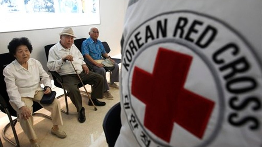 Aug. 24, 2013: South Korean applicants wait for the announcements of the names of South Korean candidates who can meet their North Korean relatives in upcoming family reunions at the headquarters of Korea Red Cross in Seoul, South Korea.