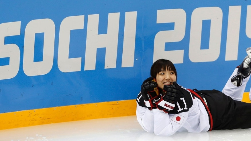 Yurie Adachi of the Japan women's ice hockey team poses for a photograph prior a practice session ahead of the 2014 Winter Olympics, Thursday, Feb. 6, 2014, in Sochi, Russia. (AP Photo/Petr David Josek)