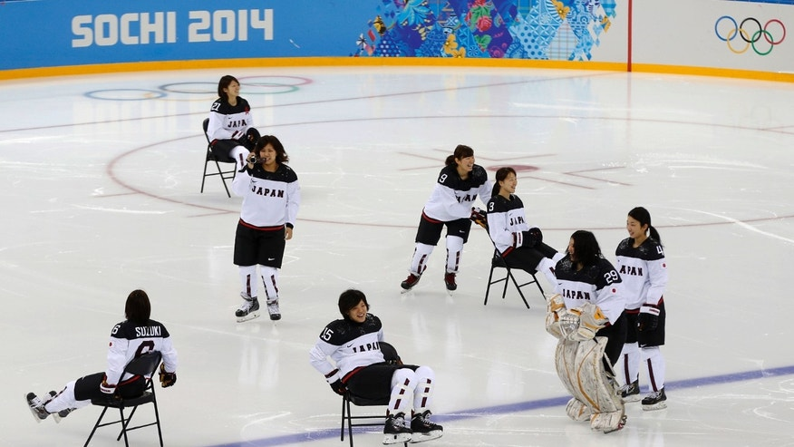 Members of the Japan women's ice hockey team slide on chairs prior their practice session ahead of the 2014 Winter Olympics, Thursday, Feb. 6, 2014, in Sochi, Russia. (AP Photo/Petr David Josek)