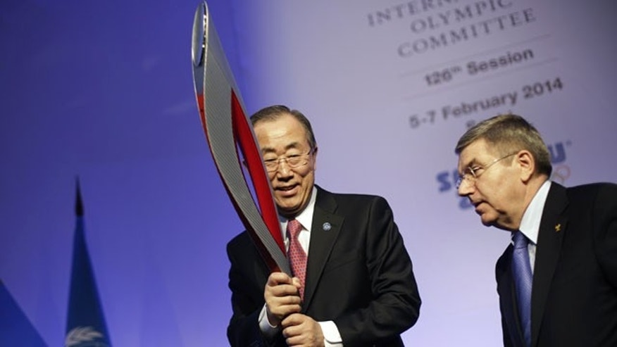 February 6, 2014: United Nations Secretary-General Ban Ki-moon, left, is handed an Olympic torch by International Olympic Committee President Thomas Bach after Ban addressed the IOC general assembly ahead of the upcoming Winter Olympics. (AP Photo/David Goldman)