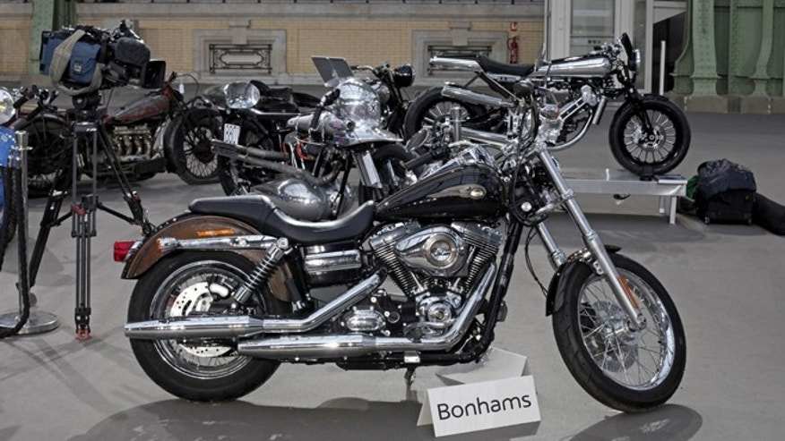 Feb. 5, 2014: The 2013 Harley Davidson Super Glide Custom A 1,585cc Harley-Davidson Dyna Super Glide, donated to Pope Francis last year and signed by him on its tank, is displayed ahead of Bonham's sale of vintage and classic cars, at the Grand Palais in Paris.