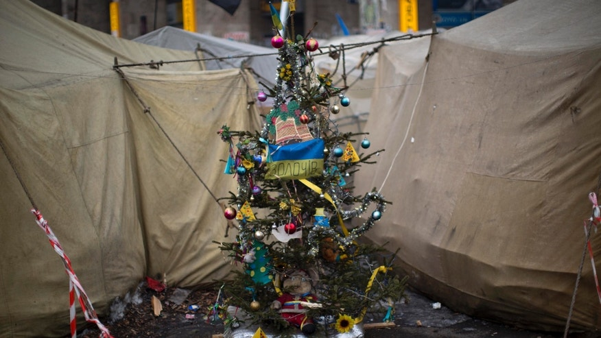 A christmas tree is seen in the middle of tents set by opposition supporters in Kiev's Independence Square, the epicenter of the country's current unrest, Ukraine, Friday, Feb. 7, 2014. Ukrainian protesters lambasted parliament on Thursday for its lack of action, and a senior U.S. diplomat arrived in Kiev to try to help find a resolution to the country's grinding political crisis. Assistant Secretary of State Victoria Nuland met separately with President Viktor Yanukovych and with opposition leaders during her two-day stay in the Ukrainian capital. (AP Photo/Emilio Morenatti)