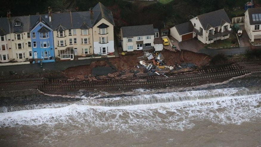 In this undated picture provided by National Rail, a railway line severely damaged by the high seas caused by winter storms is seen in Dawlish, Devon, England. Engineers have been working through the night at Dawlish to shore up a seriously damaged section of sea wall before another Atlantic storm system arrives on Saturday. The damaged railway line has meant much of Devon and Cornwall has been cut off from the rest of the country by rail. (AP Photo/Network Rail) UNITED KINGDOM OUT   -   NO SALES   -   NO ARCHIVES