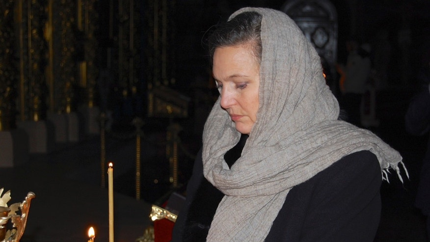 US Assistant Secretary of State Victoria Nuland lights a candle in St. Michael Cathedral in Kiev, Ukraine, Thursday, Feb. 6, 2014. Nuland arrived in the Ukrainian capital to try to help find a resolution to the protests and political crisis that have gripped the country for more than two months. The U.S. Embassy says Assistant Secretary of State Victoria Nuland is to meet President Viktor Yanukovych and leaders of the opposition during her two visit to Kiev. (AP Photo/ Pool)