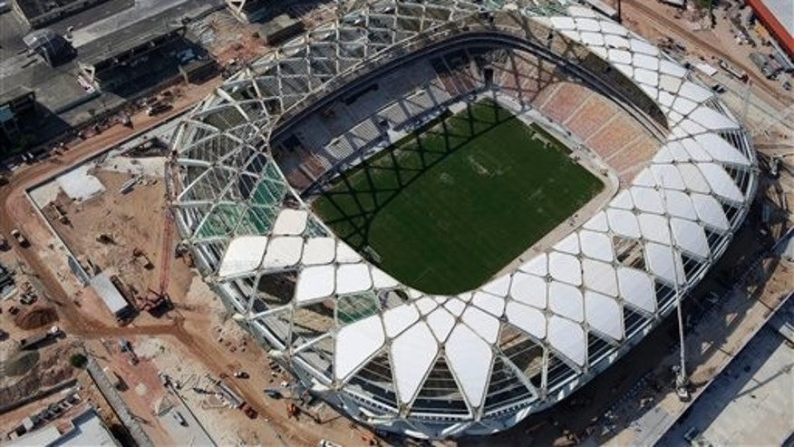 Arena da Amazonia stadium in Manaus, Brazil. A worker was injured in an accident outside this World Cup stadium, local organizers said Friday, Feb. 7, 2014. Organizers in charge of the stadium's construction said the worker was hurt while dismantling a crane that was used to install the roof.