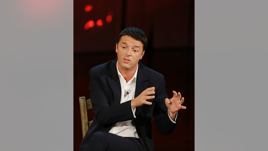 "FILE - In this Nov. 26, 2012 file photo Mayor of Florence Matteo Renzi attends the Italian State RAI TV program ""Che Tempo che Fa"", in Milan, Italy. Renzi is a brash, kid-faced dynamo who is injecting fresh blood into Italy's sclerotic politics _ and the left's great hope now that Silvio Berlusconi's criminal convictions keep the long-time leader out of power. (AP Photo/Luca Bruno, file)"