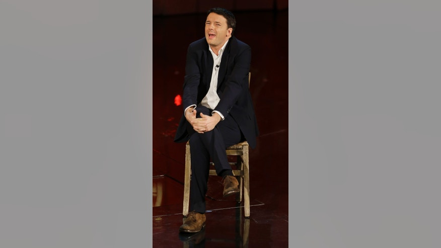 "In this Nov. 26, 2012 photo Mayor of Florence Matteo Renzi attends the Italian State RAI TV program ""Che Tempo che Fa"", in Milan, Italy. Renzi is a brash, kid-faced dynamo who is injecting fresh blood into Italy's sclerotic politics _ and the left's great hope now that Silvio Berlusconi's criminal convictions keep the long-time leader out of power.  (AP Photo/Luca Bruno)"