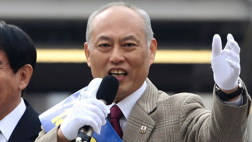 FILE - In this Jan. 25, 2014 file photo, former Health Minister Yoichi Masuzoe, a candidate for the Tokyo gubernatorial election, delivers a speech during his election campaign rally in Tokyo.  Two charismatic former prime ministers joining forces on a rare anti-nuclear power ticket are pitted against Masuzoe and a human-rights activist in the election to lead Japan's capital.  Japanese media polls say Masuzoe, more moderate on nuclear power, is leading. A lawyer known for human rights cases and a former military officer are also running.  (AP Photo/Koji Sasahara, File)