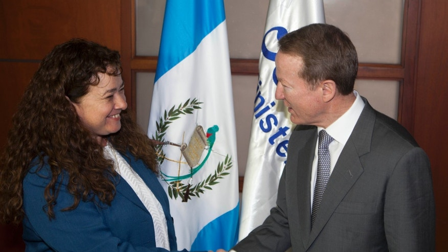 Guatemala's Attorney General Claudia Paz y Paz, left, and Assistant Secretary of State for International Narcotics and Law Enforcement Affairs (INL) William R. Brownfield shakes hands during a photo opportunity in Guatemala City, Monday, Feb. 10, 2014. Brownfield is in an official visit to Guatemala and Honduras this week. (AP Photo/Moises Castillo)