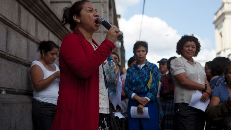 Human rights activist Iduvina Hernandez shouts slogan in support of Guatemala's Attorney General Claudia Paz y Paz during a protest in front of Congress in Guatemala City, Monday, Feb. 10, 2014. Human rights groups in Guatemala are protesting the Supreme Court's decision to oust the country's crusading attorney general seven months before her term was set to end.  (AP Photo/Moises Castillo)