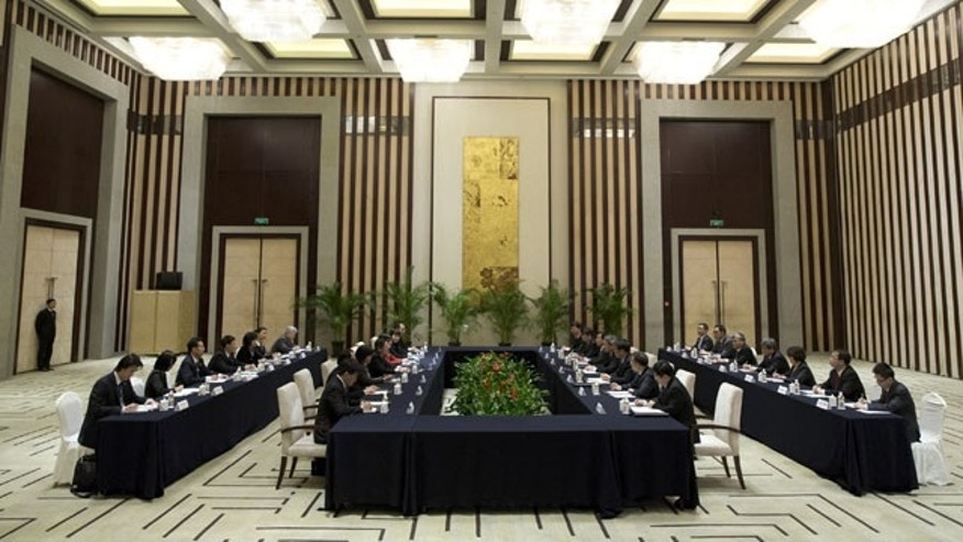 February 11, 2014: Chinese and Taiwanese negotiators, including Zhang Zhijun, director of China's Taiwan Affairs Office, and Wang Yu-chi, head of Taiwan's Mainland Affairs Council, talk during their meeting in Nanjing, in eastern China's Jiangsu Province. (AP)
