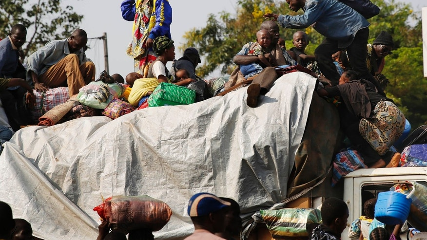 Feb. 7, 2014: At PK12, the last checkpoint at the exit of the town, thousands of Muslim residents from Bangui and Mbaiki flee the Central African Republic town of Bangui in a mass exodus using cars, pickups, trucks, lorries and motorcycles, escorted by Chadian troops.