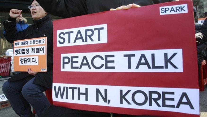 February 11, 2014: A protester shouts slogans during a rally opposing the scheduled visit of Secretary of State John Kerry near the U.S. embassy in Seoul, South Korea. Kerry will visit South Korea on Thursday to discuss issues of mutual concerns, including efforts to denuclearize North Korea.(AP Photo/Ahn Young-joon)