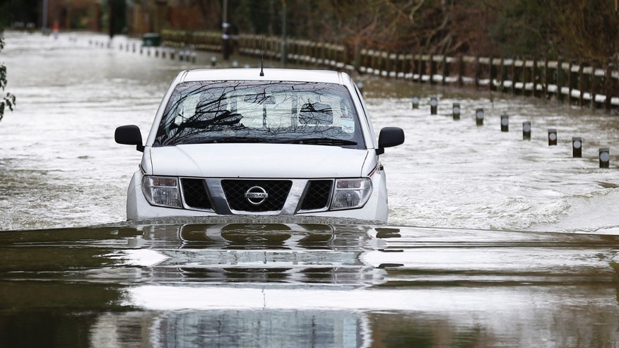 Feb. 11, 2014: A car drives through a flooded road  in Shepperton, England.