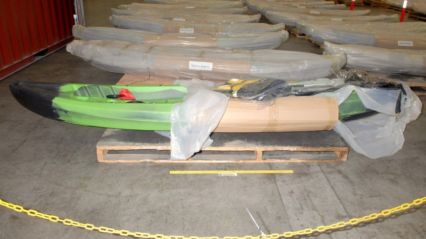 In this Feb. 5, 2014 image provided by the Australian Federal Police, kayaks are stored at a warehouse in Sydney after police discovered methamphetamine hidden inside the kayaks. Five people were arrested in Sydney on Tuesday, Feb. 11, 2014, after customs officials discovered 183 kilograms (403 pounds) of meth, worth about 180 million Australian dollars ($162 million), while inspecting a shipment of kayaks from China, the Australian Federal Police said. (AP Photo/Australian Federal Police) EDITORIAL USE ONLY