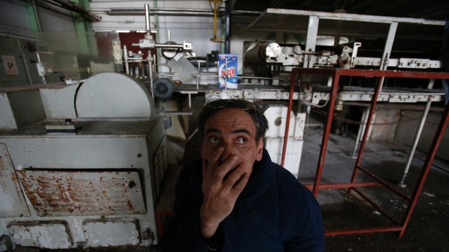 "Bosnian man, Admir Becic, an employee of the detergent factory ""Dita"" looks on inside the factory in Bosnian town of Tuzla, 140 kms north of Sarajevo on Wednesday, Feb. 12, 2014. The violence engulfing Bosnia in recent days, with scenes of burning government buildings and protesters pelting police with stones, has many root causes. One of them is the failed privatizations of state-owned companies. (AP Photo/Amel Emric)"