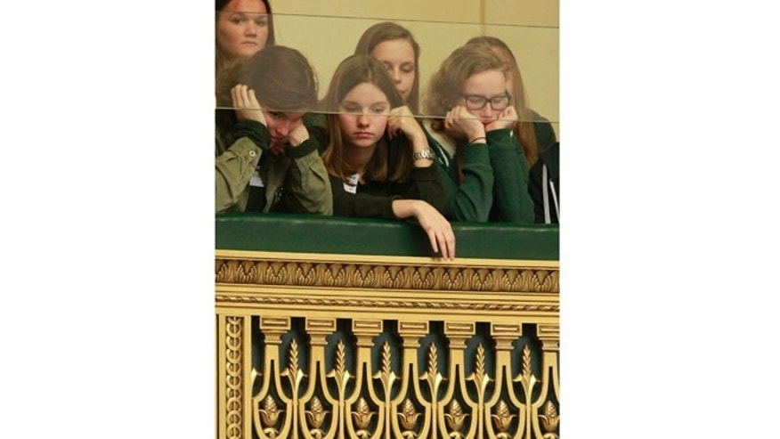 Feb. 13, 2014: Visitors look down from the balcony onto the plenary room, as Belgian politicians gather to vote the bill on child euthanasia at the Belgian federal parliament in Brussels extending to children a legal option already possessed by the country's adults.
