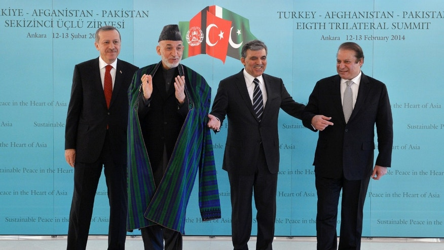 In this photo released by the Turkish Presidency Press Office, Turkish Abdullah Gul, second right, Turkish Prime Minister Recep Tayyip Erdogan, left, Afghan President Hamid Karzai, second left, and Pakistan Prime Minister Nawaz Sharif pose for cameras after their meeting in Ankara, Turkey. Karzai and  Sharif are in Turkey for the 8th Afghanistan-Pakistan-Turkey Trilateral Summit.(AP Photo/Murat Cetinmuhurdar, Turkish Presidency Press Office, HO)